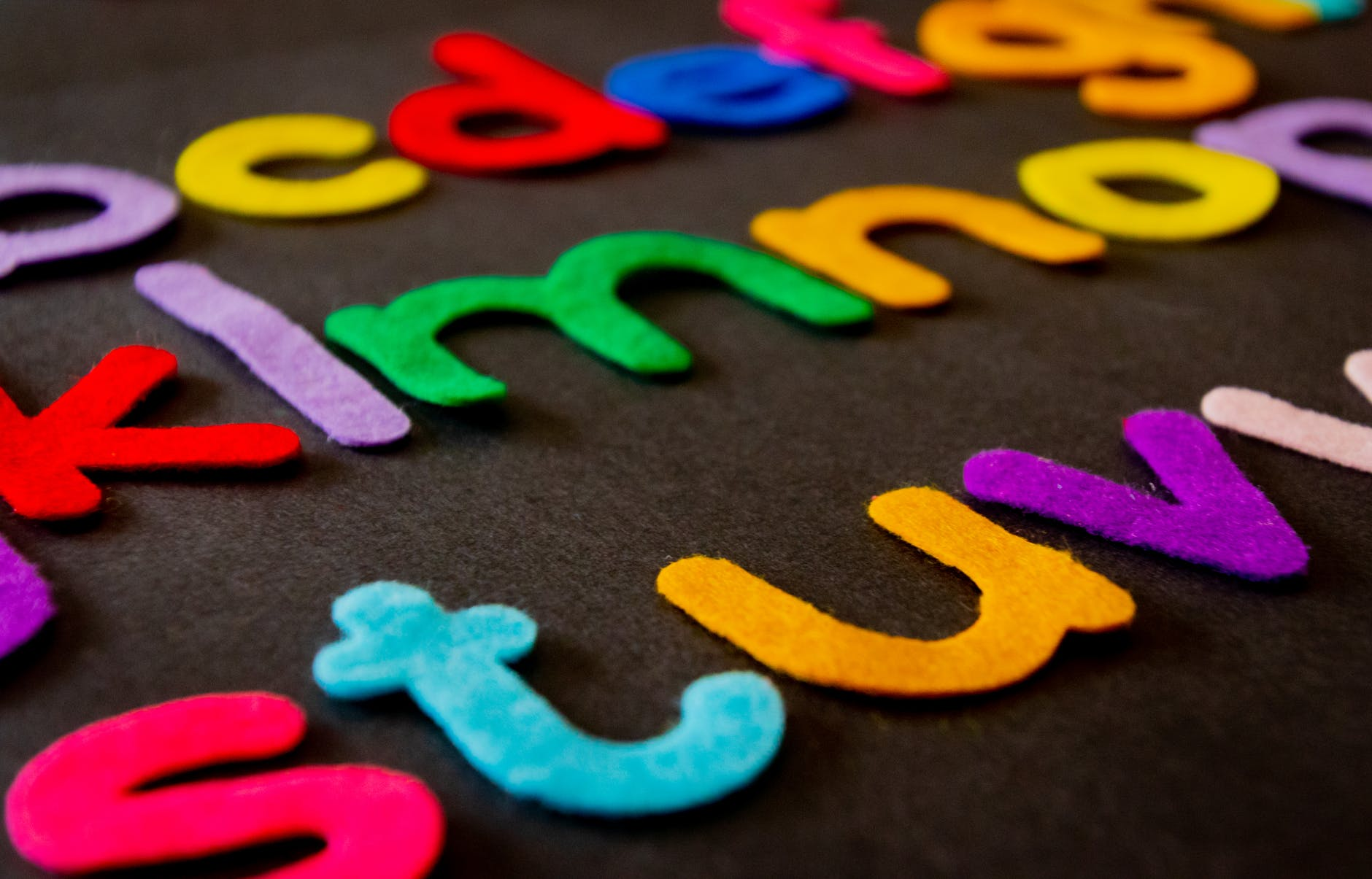 closeup photo of assorted color alphabets